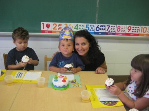 Birthdays are special milestones and memories in the making.  Here, a mother and son share cupcakes with friends.