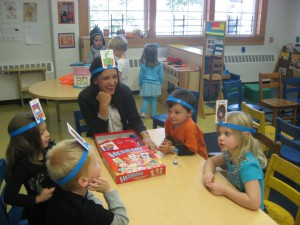 Parents are welcome to join in the classroom fun.Here, a  parent plays a game with her son and his classmates.
